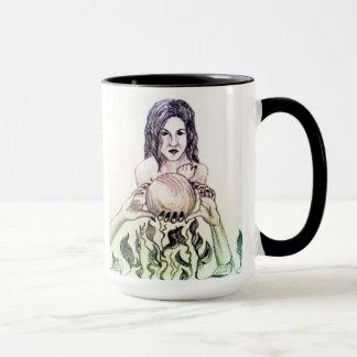Girl looking into a crystal ball mug