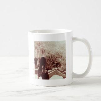 Girl on a ledge coffee mug