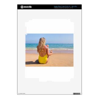 Girl on beach smearing sunscreen on skin.JPG Skins For iPad 3