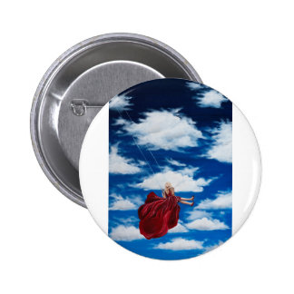 Girl on swing in clouds button