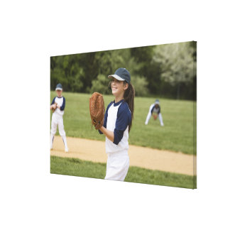Girl pitching in little league softball game canvas print