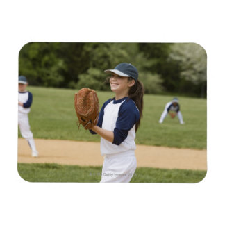Girl pitching in little league softball game magnet