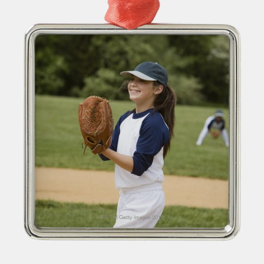 Girl pitching in little league softball game metal ornament