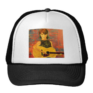 girl playing acoustic guitar trucker hat
