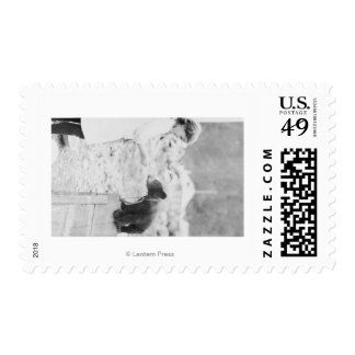 Girl Playing with Bear Cub in Seward 2 Stamp