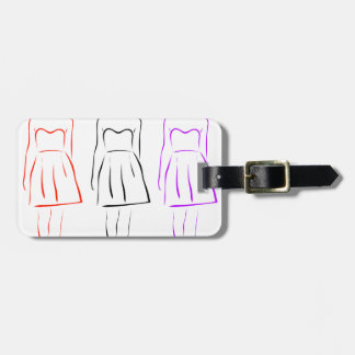 Girl posing in fashionable outfit bag tag