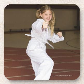 Girl practicing karate beverage coaster