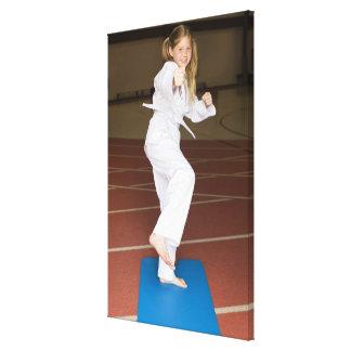Girl practicing karate canvas print