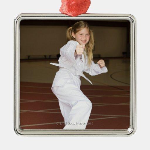 Girl practicing karate christmas tree ornament