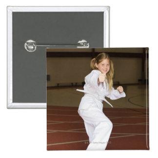 Girl practicing karate pinback button