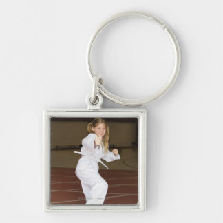 Girl practicing karate Silver-Colored square keychain