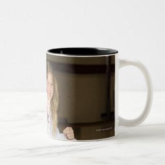 Girl practicing karate Two-Tone coffee mug