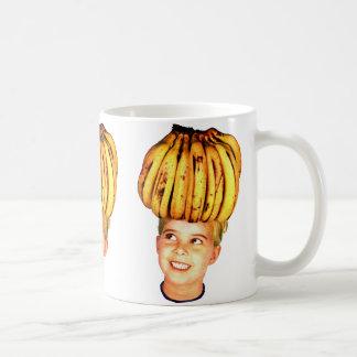 Girl principal del plátano del anuncio de los taza
