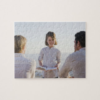 Girl reading a book in front of her parents jigsaw puzzle
