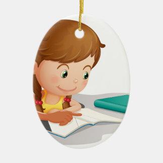 girl reading book ceramic ornament