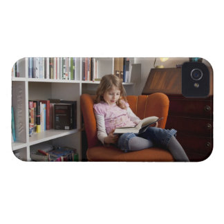 Girl reading by the bookshelf iPhone 4 covers
