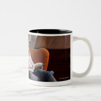 Girl reading by the bookshelf Two-Tone coffee mug