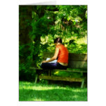 Girl Reading in Park Greeting Cards