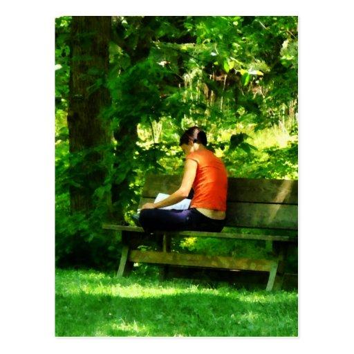 Girl Reading in Park Postcard