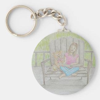 girl reading keychain