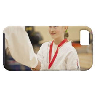 Girl receiving a medal at a Karate championship iPhone 5 Cases
