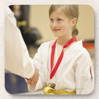 Girl receiving a medal at a Karate championship Beverage Coasters