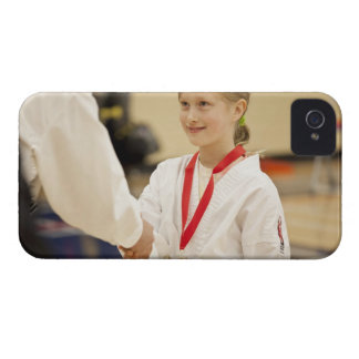Girl receiving a medal at a Karate championship iPhone 4 Case