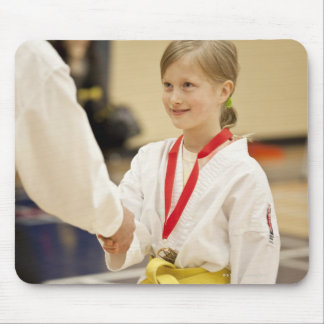 Girl receiving a medal at a Karate championship Mouse Pad
