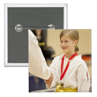 Girl receiving a medal at a Karate championship Pinback Button