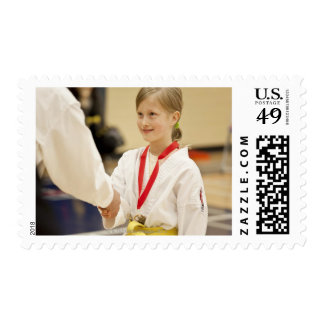 Girl receiving a medal at a Karate championship Postage Stamp