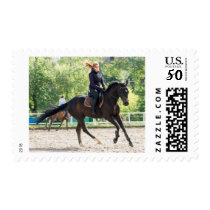 Girl riding a horse postage