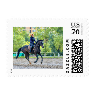Girl riding a horse professionally postage