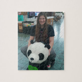 Girl riding a panda bear jigsaw puzzle