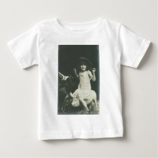 girl riding a sow baby T-Shirt