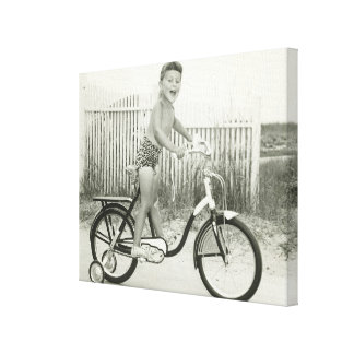 Girl Riding Bicycle Canvas Print