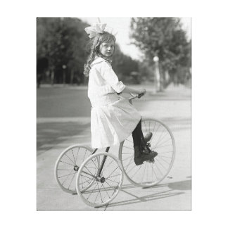 Girl Riding Tricycle, 1917 Canvas Print
