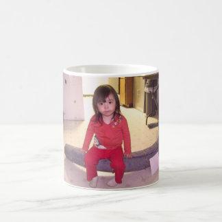 girl sat on tusk ak coffee mugs