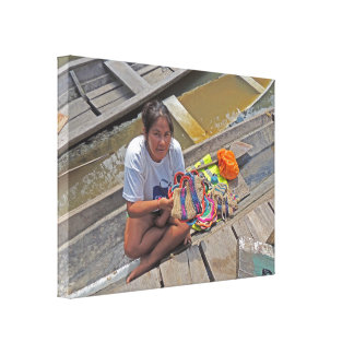 Girl Selling Crafts from Her Boat in the Amazon Canvas Print