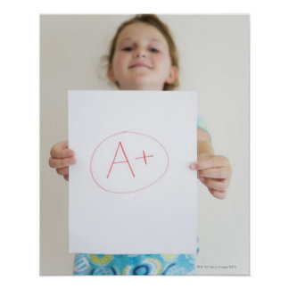 Girl showing off A+ grade on paper Poster