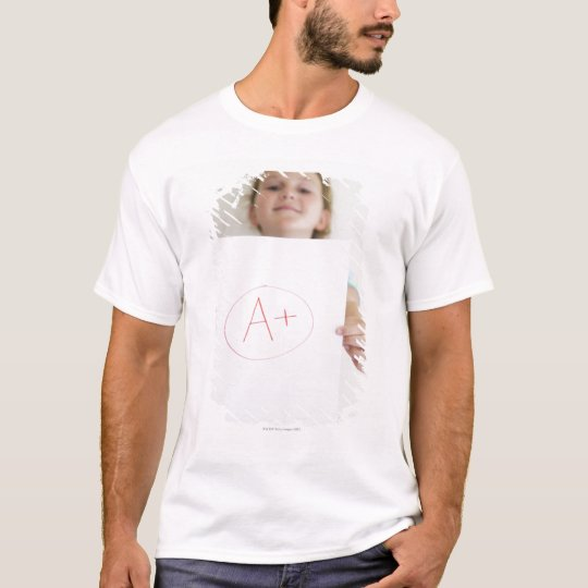 Girl showing off A+ grade on paper T-Shirt