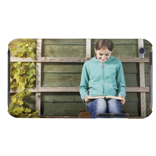 Girl sitting and reading book near vine iPod touch cover