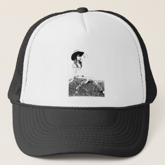 girl sitting on hay bale trucker hat