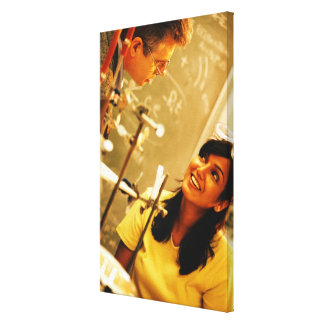 Girl smiling at teacher in chemistry lab canvas prints