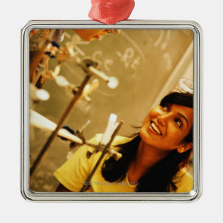 Girl smiling at teacher in chemistry lab metal ornament