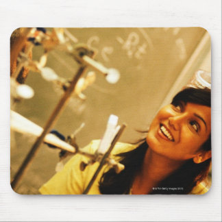 Girl smiling at teacher in chemistry lab mouse pad