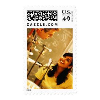 Girl smiling at teacher in chemistry lab stamp