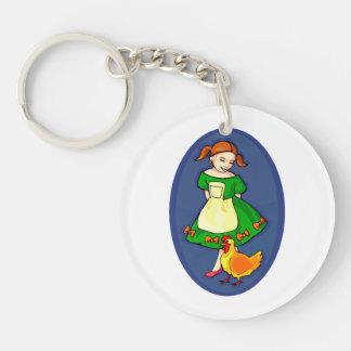 girl standing green dress chicken blue oval keychain