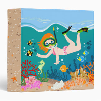 Girl swimming and diving with tropical fish binder