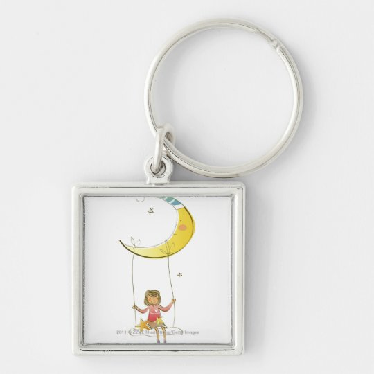 Girl swinging on a rope hanging from crescent moon keychain