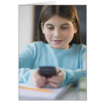 Girl texting in classroom card